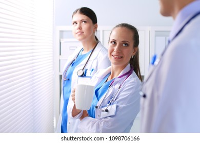 Young team or group of doctors standing in hospital . doctors