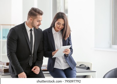 Young team of lawyers at workplace