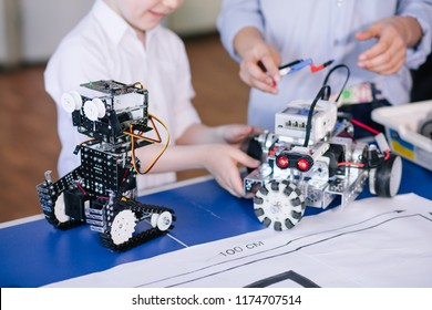 Young technical team working on toy. Technical toy on table full of details. education technopogy science children creativity concept