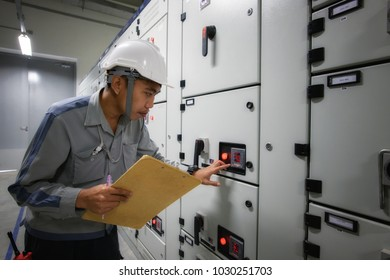 Young technician make a visual checking status switchgear electrical energy distribution substation