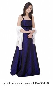 Young teen biracial girl in elegant, dark blue dress gown isolated on white