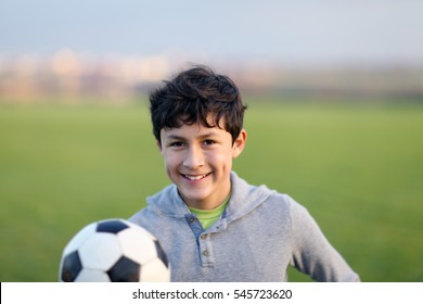 Young teen boy in the playing field during the golden hour - shallow depth of field