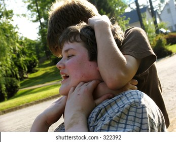 young teen boys fighting