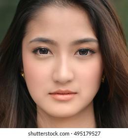 Young teen girl Asian woman face close up