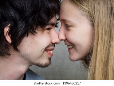 Young teen girl in love with her boy friend face to face close-up portrait