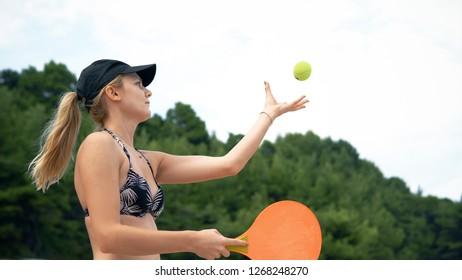 Young Teen Girl Playing Beach Tennis