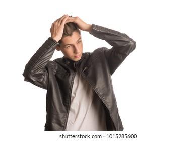 Young Teen Grabbing his Head