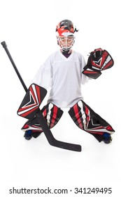 A young teen hockey goaler in studio white background