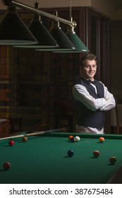 Young teen playing pool