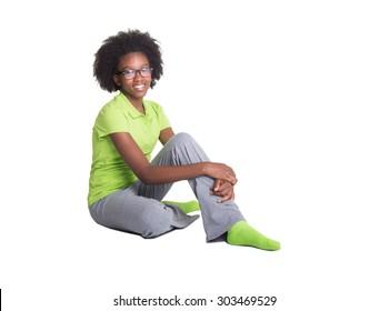 Young teen sitting on floor isolated
