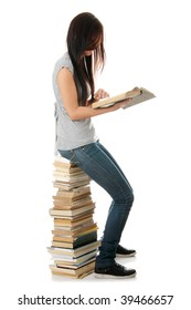 Young teen woman sitting on books isolated
