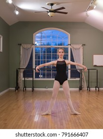Young teenage ballet dancer in second position