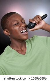 Young teenage black African American boy singer performing at a concert