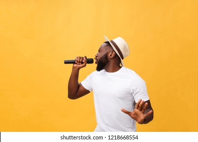 Young teenage black African American boy singer performing at a concert.