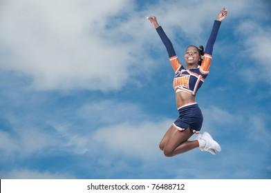 A young teenage black african American cheerleader