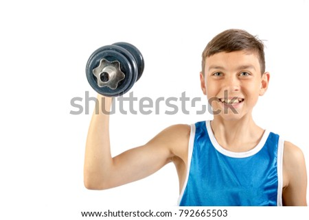 Young teenage boy exercising with dumbbells isolated against a white background