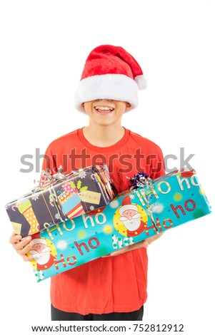 Young teenage boy holding  Christmas gifts, isolated on white background