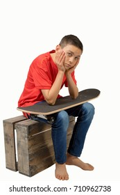 Young teenage caucasian boy with his skateboard