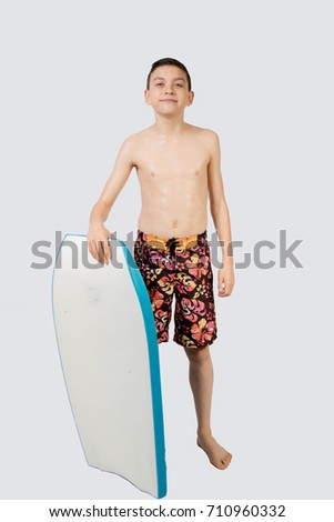 Young teenage caucasian boy with his body board