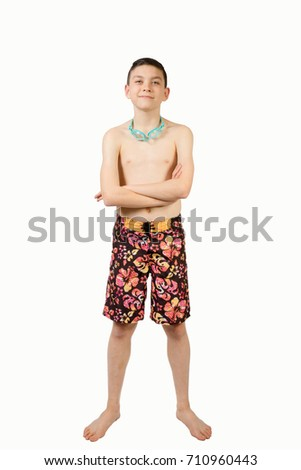 Young teenage caucasian boy wearing swimwear