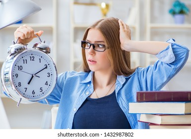 Young teenage female student preparing for exams at home