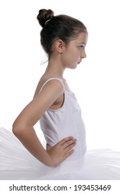 Young teenage girl in a ballet dress posing on a white background