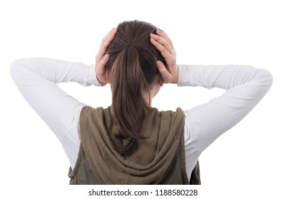 young teenage girl closes her ears back view isolated  on white