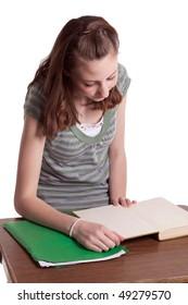 a young teenage girl doing her homework