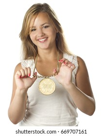 young teenage girl with gold medal smiling on white