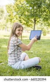 Young teenage girl loving nature, enjoying her day in the park