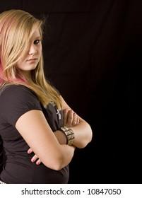 Young teenage girl posing on black background