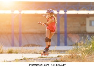 Young teenage girl speed skating on rollerdrome.