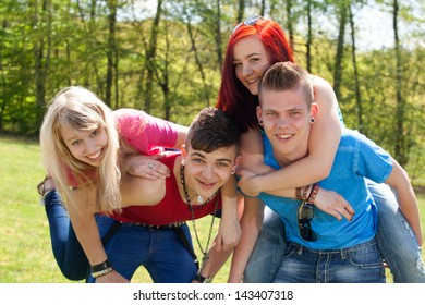 Young teenage group with colored shirts are having fun