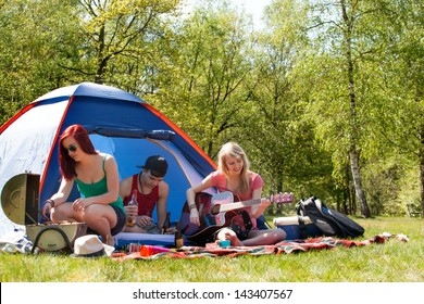 Young teenage group is having fun on a camping. Do not use this image for alcohol related subjects please.