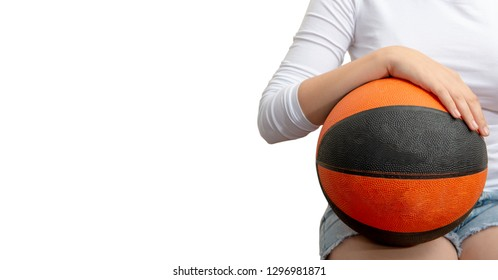 young teenager with a basketball on the white background
