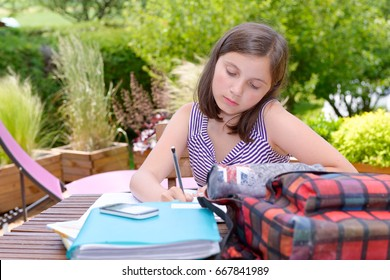 A young teenager doing her homework