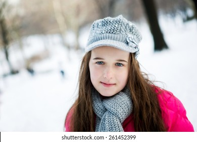 A young teenager dressed for winter in the snow in central park New York