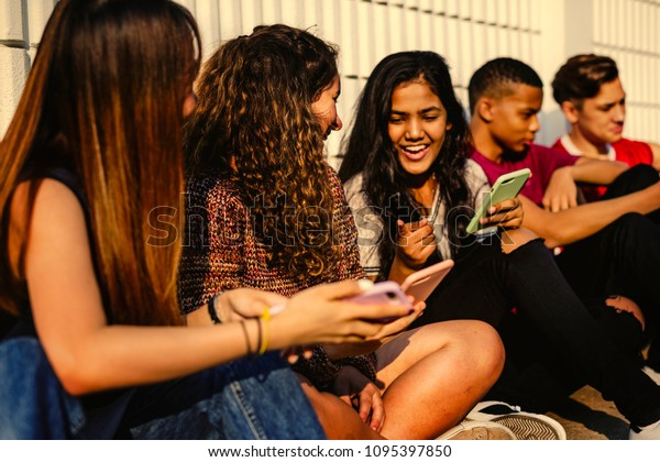 Young teenager friends chilling out together