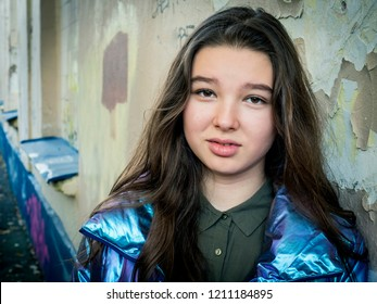 Young teenager girl brunette close-up portrait, street photo