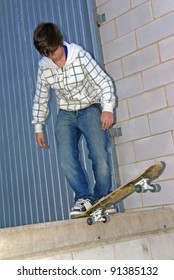 Young teenager playing with the skateboard