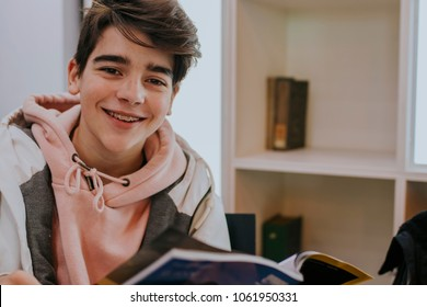 young teenager reading the book or magazine