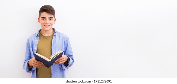 young teenager student with book isolated on white background