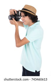Young teenager taking photos of his trip. Isolated on white background.