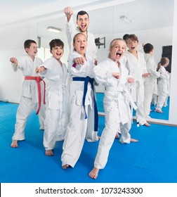 Young teenagers happy to attend karate class on self-defense