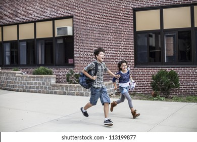Young teenagers are running from from school