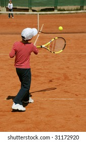 young tennis player ready to hit the ball