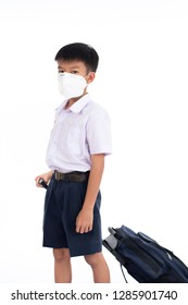 Young Thai boy put a mas on his face to protect a dust in a pollution air.