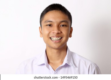 The young Thai student boy on the white background.