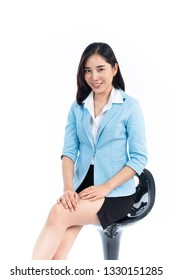 Young Thai woman in business dress sit on a chair on white background.