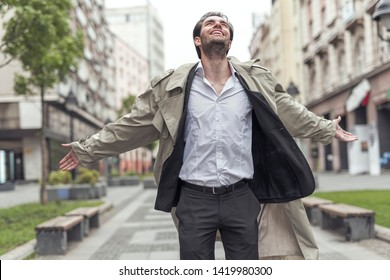 Young thankful man walking the urban streets of his city, appreciating life and the beauty around him, positive mindset